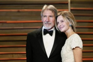 Actor Harrison Ford and his wife Calista Flockhart arrive at the 2014 Vanity Fair Oscars Party in West Hollywood, California March 2, 2014. CREDIT: REUTERS/DANNY MOLOSHOK