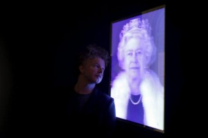 Artist Chris Levine poses next to his lenticular image of Britain's Queen Elizabeth during a press view at the National Portrait Gallery in London, Britain in this May 16, 2012 file photo. REUTERS/Stefan Wermuth/Files